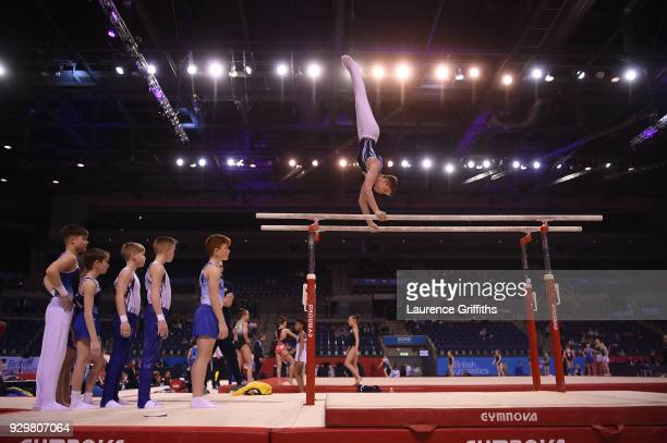 Athletes warm up on the Paralell Bars during the Men's Under 14 AllAround Gymnastics British Championships at Echo Arena on March 8 2018 in Liverpool...