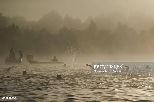 Athletes warm up prior to start he Ironman 703 Pays d'Aix swimming course on May 14 2017 as the fog clears up at Lake Peyrolles France