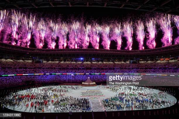 Athletes watch as Fireworks go off during the Opening Ceremony for the Tokyo 2020 Olympic Games at Tokyo Olympic Stadium on Friday, July 23. 2021.