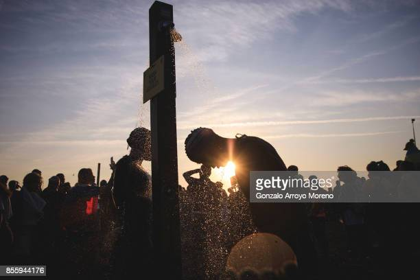 Athletes wet their suit on a shower displaced on the beach before starting the swimming course of the IRONMAN Barcelona on September 30 2017 in...