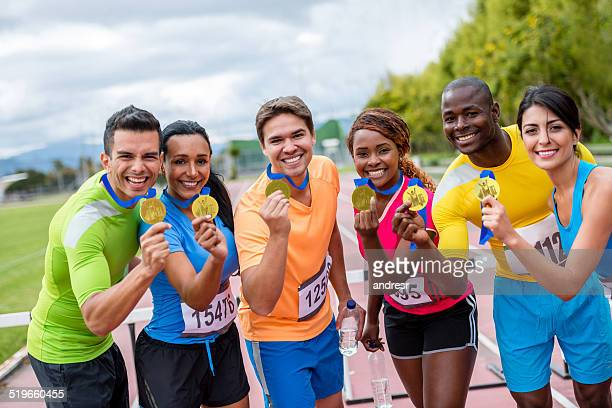 athletes with gold medals - medalist stock pictures, royalty-free photos & images