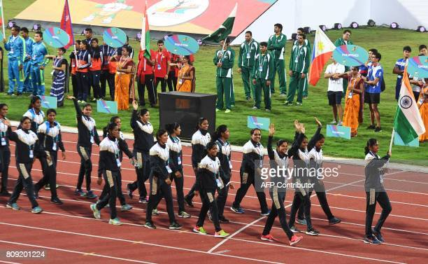Athletes with the Indian team take part in the opening ceremony of the 22nd Asian Athletics Championships at Kalinga Stadium in Bhubaneswar on July 5...