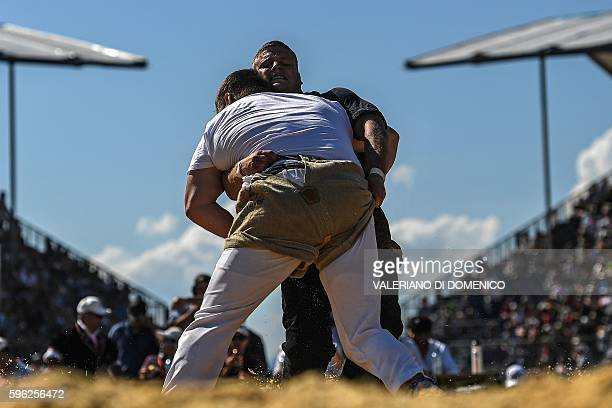 Athletes wrestle during the first day of the Federal Alpine Wrestling Festival on August 27 2016 in Payerne western Switzerland The Federal Alpine...