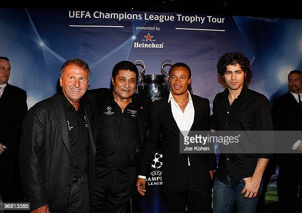 Athletes Zico Eusebio Edgar Davids and actor Adrian Grenier attend the Heineken Brings UEFA Champions League Trophy to the US event at 230 Fifth...
