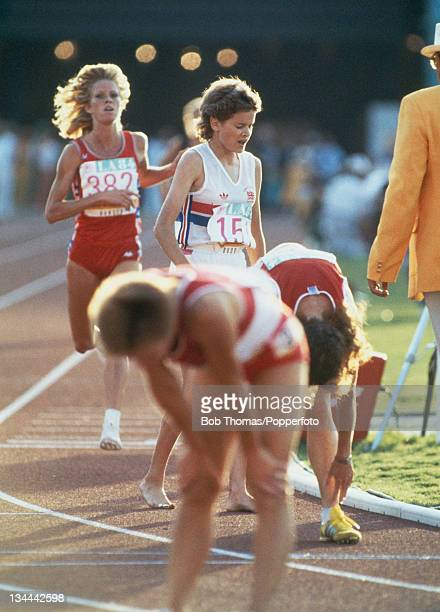Athletes Zola Budd of Great Britain and Joan Hansen of the United States cross the finish line in 7th and 8th place in the final of the Women's 3000...