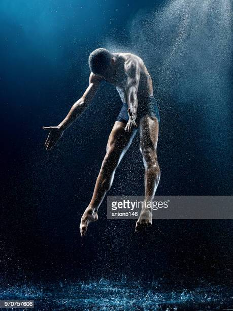 athletic ballet dancer performing with water - dancing foto e immagini stock