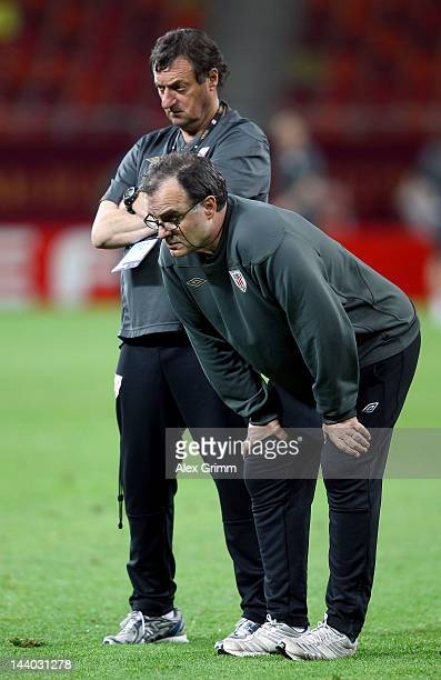 Athletic Bilbao coach Marcelo Bielsa looks on with physical coach Luis Bonini during the Athletic Bilbao training session ahead of the UEFA Europa...