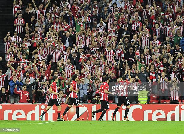 Athletic Bilbao players celebrate after scoring their team's fourth goal during the UEFA Europa League group L football match Athletic Club Bilbao vs...