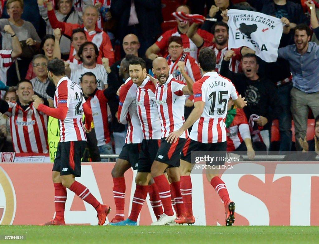 Athletic Bilbao players celebrate Spanish forward Inaki Williams' (2L) goal during the Europa League football match Athletic Club Bilbao vs Hertha BSC Berlin at the San Mames stadium in Bilbao on November 23, 2017. /