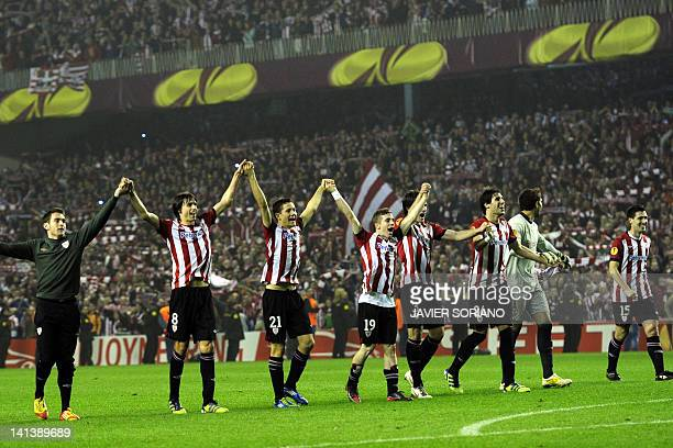 Athletic Bilbao players celebrate with supporters during the UEFA Europa round of 16 second leg football match Athletic Bilbao against Manchester...