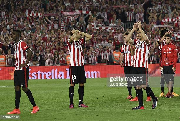 Athletic Bilbao players react at the end of the Spanish Copa del Rey final football match Athletic Club Bilbao vs FC Barcelona at the Camp Nou...