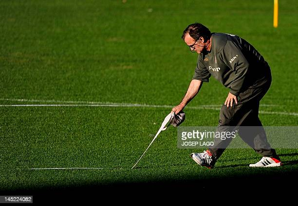 Athletic Bilbao's Argentinian coach Marcelo Bielsa takes part in a training session on the eve of the Spanish King's Cup final football match between...
