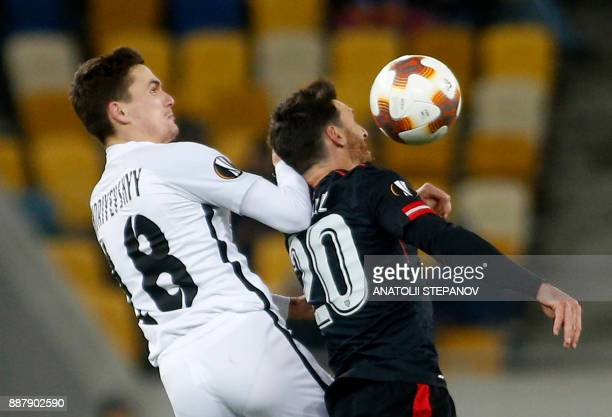 Athletic Bilbao's Aritz Aduriz fights for the ball with Zorya's Oleksandr Andriyevskiy during the UEFA Europa League Group J football match between...