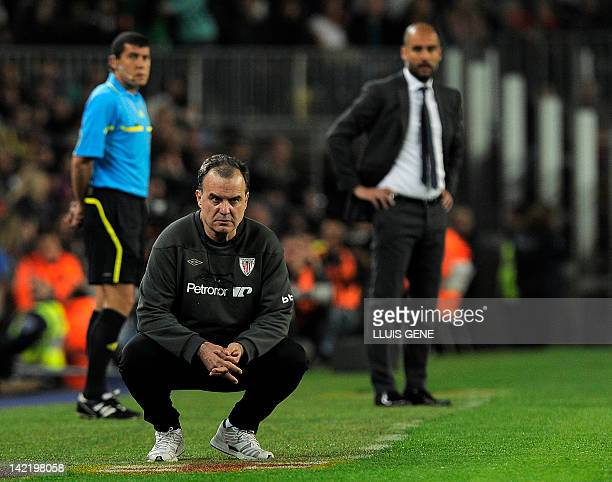 Athletic Bilbao's coach Marcelo Bielsa and Barcelona's coach Josep Guardiola look at their players during the Spanish league football match FC...