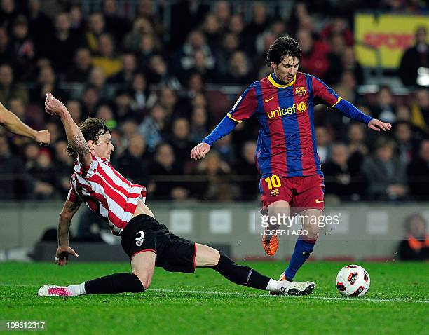 Athletic Bilbao's defender Fernando Amorebieta vies with Barcelona's Argentinian forward Lionel Messi during the Spanish league football match FC...