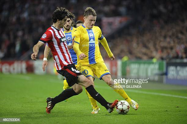 Athletic Bilbao's defender Mikel San Jose vies with Bate Borisov's forward Vitali Rodionov during the UEFA Champions League Group H football match...