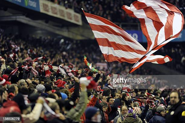 Athletic Bilbao's fans celebrate the team's victory during the Spanish Cup football match Athletic Bilbao vs Mirandes on February 7 2012 at the San...