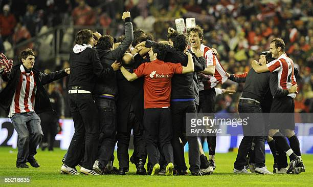 Athletic Bilbao's Fernando Llorente celebrate with teammates and supporters after winning the Spanish King's Cup semifinal match against Sevilla at...