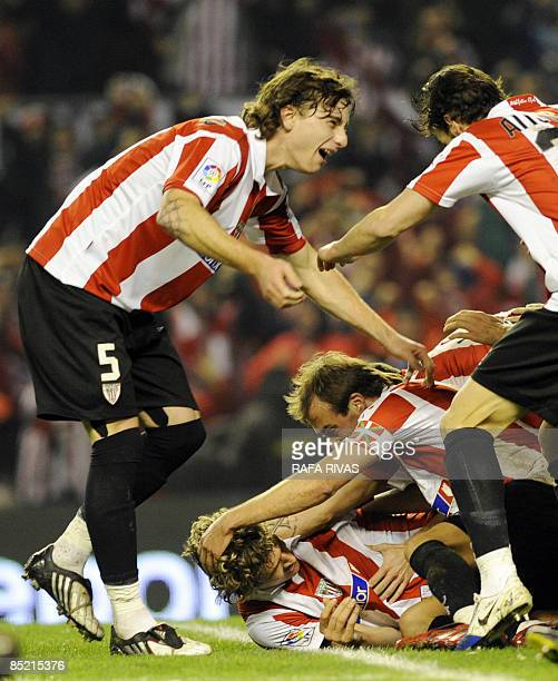 Athletic Bilbao's Fernando Llorente celebrates with teammates after scoring against Sevilla during the Spanish King's Cup semifinal match at the San...