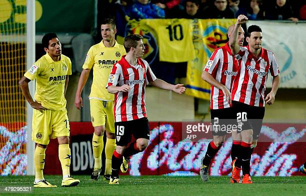 Athletic Bilbao's forward Aritz Aduriz celebrates his goal during the Spanish league football match Villarreal CF vs Athletic Club Bilbao at the El...