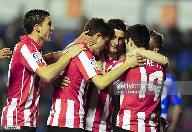 Athletic Bilbao's forward Aritz Aduriz celebrates with his teammates after scoring during the Spanish league football match Levante UD vs Athletic...