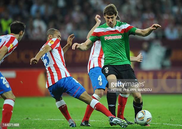 Athletic Bilbao's forward Fernando Llorente and Atletico Madrid's Brazilian defender Joa Miranda de Souza vie for the ball during the UEFA Europa...