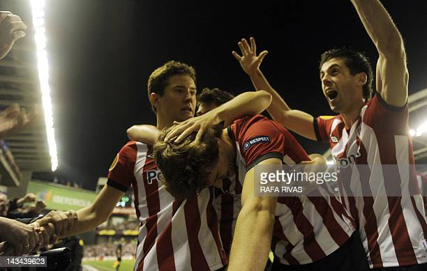 Athletic Bilbao's forward Fernando Llorente celebrates with teammates after scoring his team's third goal during the UEFA Europa League second leg...