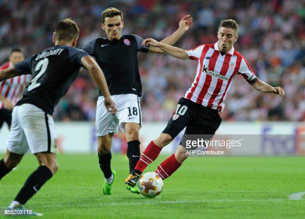 Athletic Bilbao's forward from Spain Iker Muniain vies with Zorya Louhansk's midfielder from Ukraine Oleksandr Andriyevskiy during the UEFA Europa...