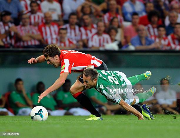 Athletic Bilbao's forward Ibai Gomez vies with Betis' defender Nacho during the Spanish league football match Athletic Bilbao vs Betis at the San...