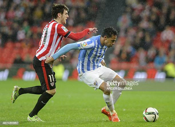 Athletic Bilbao's forward Ibai Gomez vies with Malaga's Brazilian defender Weligton during the Spanish Copa del Rey quarter final second leg football...
