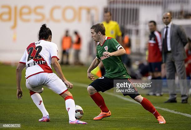 Athletic Bilbao's forward Iker Muniain vies with Rayo's Portuguese forward Lica during the Spanish league football match Rayo Vallecano vs Athletic...