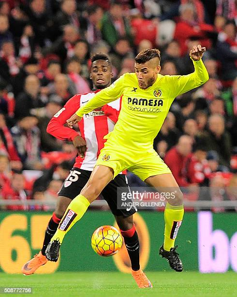 Athletic Bilbao's forward Inaki Williams Arthuer vies with Villarreal's Mexican midfielder Jonathan Dos Santos during the Spanish league football...