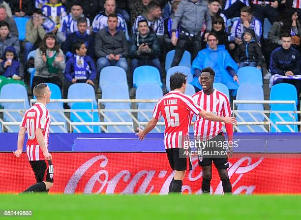 Athletic Bilbao's forward Inaki Williams Arthur celebrates with teammate defender Inigo Lekue after scoring their team's second goal during the...