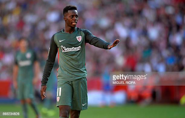 Athletic Bilbao's forward Inaki Williams gestures during the Spanish league football match Real Sporting de Gijon vs Athletic Club Bilbao at El...