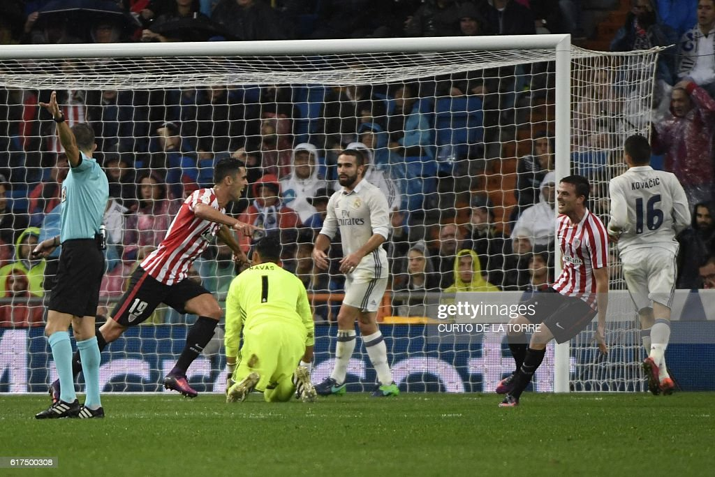 Athletic Bilbao's forward Sabin Merino (2nd L) celebrates a goal during the Spanish league football match between Real Madrid CF and Athletic Club Bilbao at the Santiago Bernabeu stadium in Madrid on October 23, 2016. / AFP / CURTO
