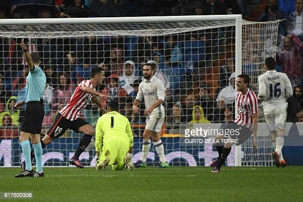 Athletic Bilbao's forward Sabin Merino celebrates a goal during the Spanish league football match between Real Madrid CF and Athletic Club Bilbao at...