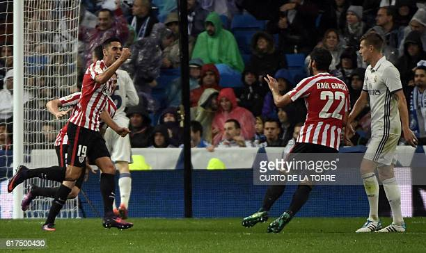 Athletic Bilbao's forward Sabin Merino celebrates a goal with Athletic's midfielder Raul Garcia during the Spanish league football match between Real...