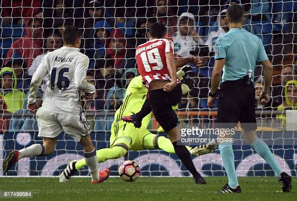 Athletic Bilbao's forward Sabin Merino shoots to score a goal during the Spanish league football match between Real Madrid CF and Athletic Club...