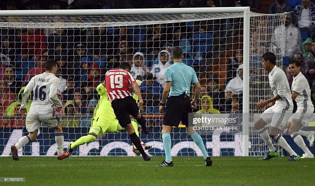 Athletic Bilbao's forward Sabin Merino (3rd L) shoots to score a goal during the Spanish league football match between Real Madrid CF and Athletic Club Bilbao at the Santiago Bernabeu stadium in Madrid on October 23, 2016. / AFP / CURTO
