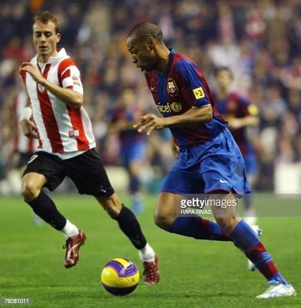 Athletic Bilbao's Fran Yeste vies with Barcelona's French Thierry Henry during a Spanish league football match 27 January 2008 at San Mames stadium...