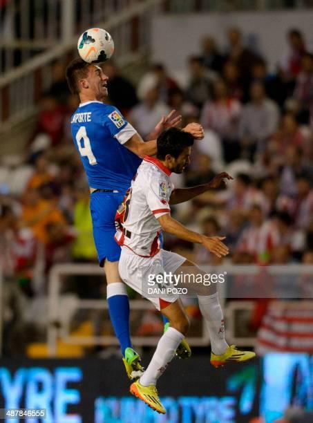 Athletic Bilbao's French defender Aymeric Laporte vies with Rayo Vallecano's midfielder Bueno during the Spanish league football match Rayo Vallecano...