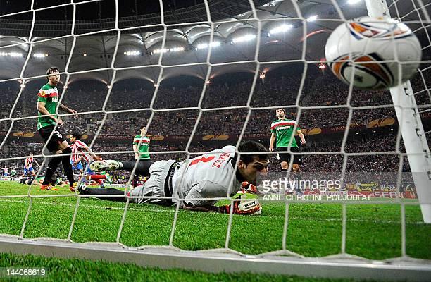 Athletic Bilbao's goalkeeper Gorka Iraizoz looks at the ball touching the net as Atletico Madrid's Colombian forward Radamel Falcao scores a goal...
