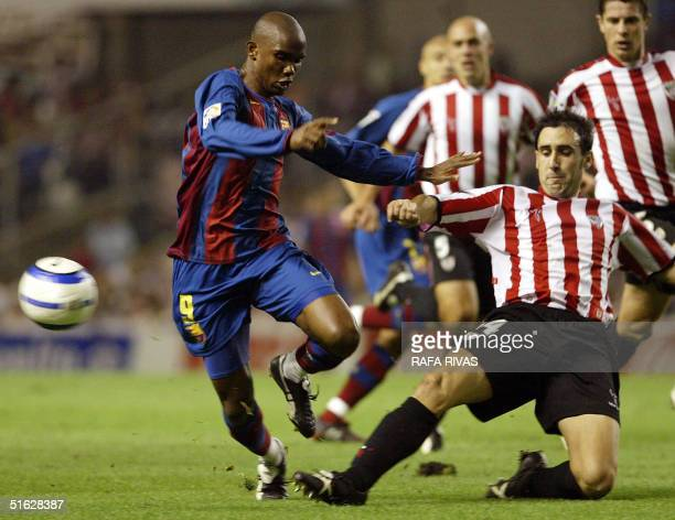 Athletic Bilbao's Luis Prieto vies with Barcelona Cameroonian Samuel Eto'o 30 October 2004 during a Spanish league match at San Mames stadium in...