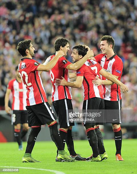 Athletic Bilbao's midfielder Benat Etxebarria is congratulated by teammates midfielder Raul Garcia defender Mikel San Jose and French defender...