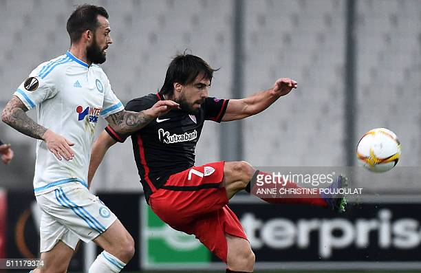 Athletic Bilbao's midfielder Benat Etxebarria Urkiaga kicks the ball next to Marseille's Scottish forward Steven Fletcher during the UEFA Europa...