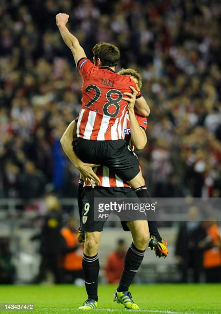 Athletic Bilbao's midfielder Ibai Gomez is congratulated by teammate forward Fernando Llorente after scoring during the UEFA Europa League second leg...