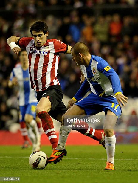 Athletic Bilbao's midfielder Javi Martinez vies with Espanyol's Slovenian midfielder Vladimir Weiss during the Spanish league football match Athletic...