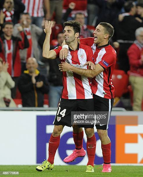 Athletic Bilbao's midfielder Markel Susaeta is congratulated by his teammate midfielder Oscar de Marcos after scoring his team's third goal during...