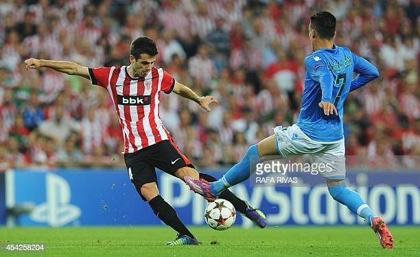 Athletic Bilbao's midfielder Markel Susaeta vies with Napoli's Spanish forward Jose Maria Callejon during the UEFA Champions League playoff second...