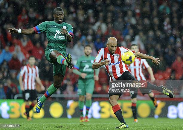Athletic Bilbao's midfielder Mikel Rico shoots to score next to Levante's Senegalese midfielder P Diop during the Spanish league football match...